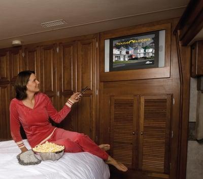 Woman Watching House Hunter Recording