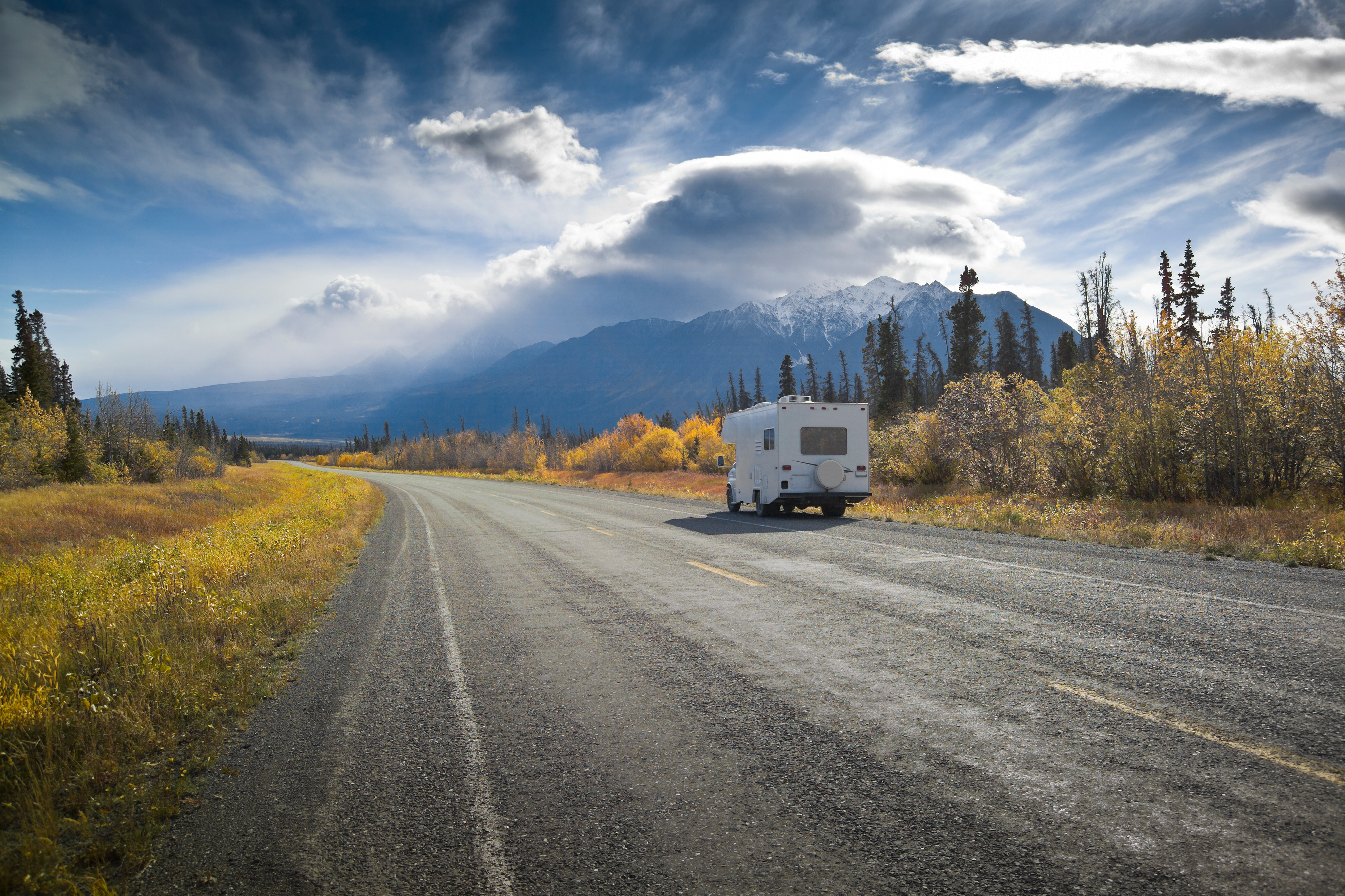 RV_Camper_on_the_road_heading_toward_mountains.jpg